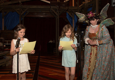 Sophia Smith (left) and Sienna Wanagas recite from Romeo and Juliet from the Folger Theatre stage. Cam Magee (right) is Mistress of the Revels.