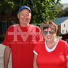 Rick and Eileen Miller wait for the parade