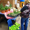 Debbie Blank | The Herald-Tribune       <br /> Vendor Beth Harnist (left), Adopt-A-Plant Garden Center, Harrison, Ohio, owner, answers questions about her greenhouse-grown herbs and hydroponic lettuce.