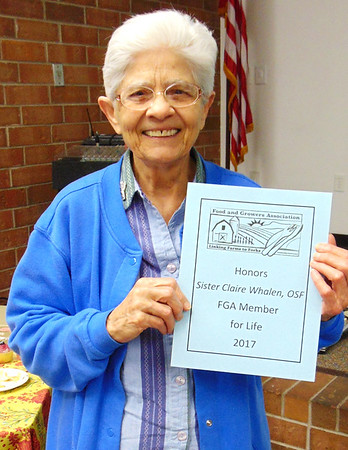 Debbie Blank | The Herald-Tribune<br /> Sister Claire Whalen of the Sisters of St. Francis, Oldenburg, was honored with an FGA lifetime membership for her work helping to establish the Food and Growers Association and its former Community-Supported Agriculture weekly boxes, plus her efforts educating ciitizens on how to use local produce and promoting the Batesville Farmers' Market.