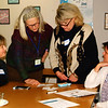 "Debbie Blank | The Herald-Tribune<br /> Carla Austin (from left), Batesville; Mary Meyer, Oldenburg; and Mellena Kess and Wende Lambert, Batesville, each were given cards by Indianapolis seventh-grade science teacher Ronak Shah. Here they try to match cards with disease descriptions and those with foods that can alleviate symptoms in the workshop ""Eating Your Vegetables: How to Trick Kids Into Loving Healthy Food."""