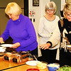 "Debbie Blank | The Herald-Tribune<br /> Batesville attendees (from left) Jana Schlichte, Shirley Waldron and Mellena Kess make vegetable sandwiches with healthy ranch dressing. The teacher encourages students to create plant part sandwiches with vegetable stems, leaves, fruits, roots and flowers. ""I want them to absorb the flavors of the vegetables."""