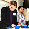 "Debbie Blank | The Herald-Tribune<br /> Teacher Ronak Shah (right) tells students, ""The wider rainbow I get in my diet, the better."" He advised attendees, ""In general, if you only eat one color, you can't solve all the (health) problems you have."" Dr. Chris Ault is helping him cut up herbs and onions for a healthy ranch dressing."