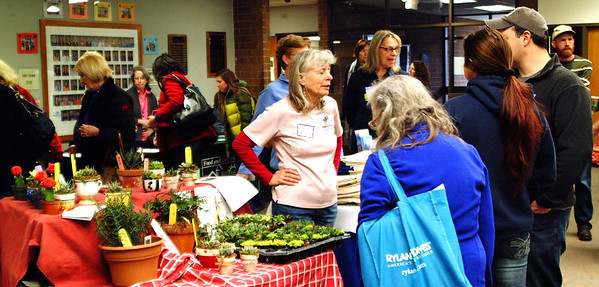 Debbie Blank | The Herald-Tribune<br /> Herbs, vegetables, fruits, meats, teas, grains, books and gardening tools were among the wares for sale at a morning market, which was open to participants and the public.