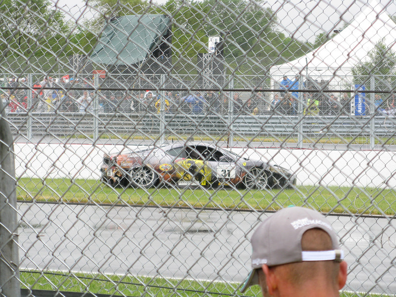 This guy spun around and smacked the inside wall of the hairpin. Rear suspension got tweaked. It was raining pretty good.