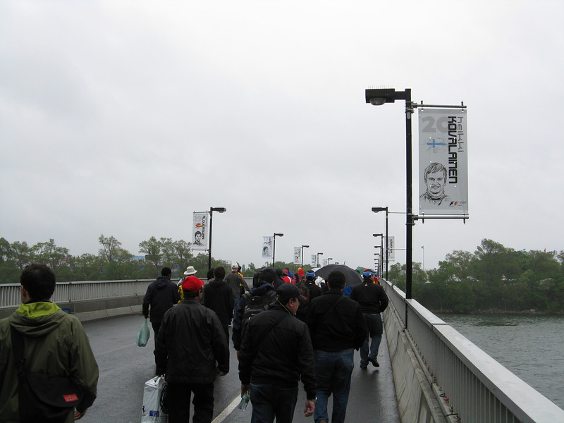 Crossing the pedestrian bridge. Flags for each driver by number.