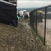 Muddy mess, and quite slippery to get down to the General Admission seating in front of the turn 1 grandstand.