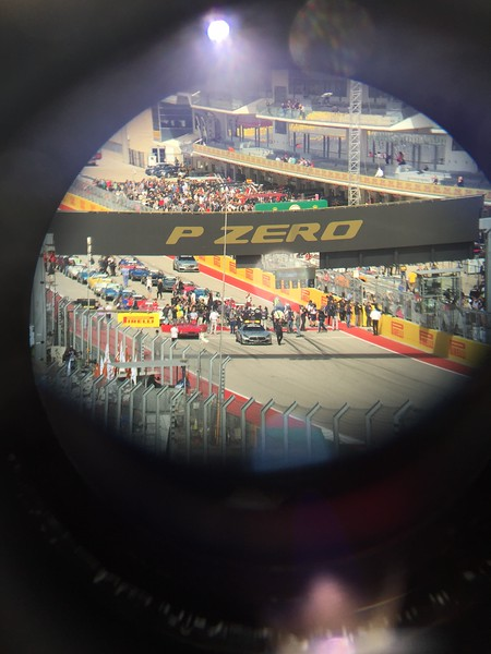 Using the binoculars to try and capture the driver parade line up. Lots of vintage Corvettes.