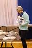 Fay Brunning examing historic photographs