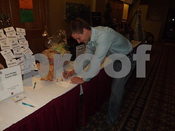 Josh Mason bidding on auction prizes.