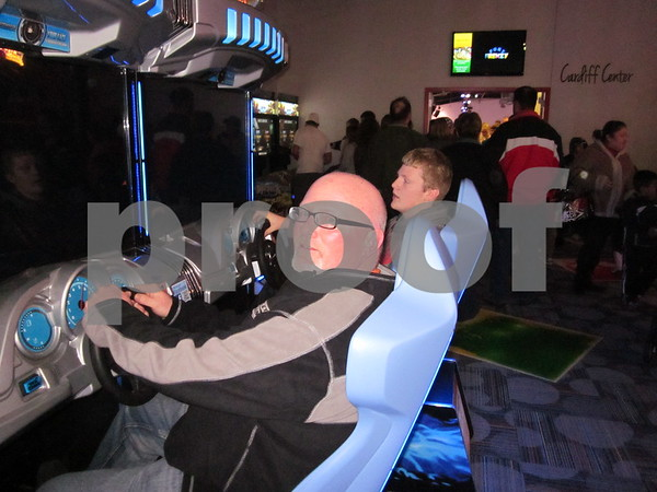 Todd Harrison and son Brandt race against each other at Fort Frenzy.