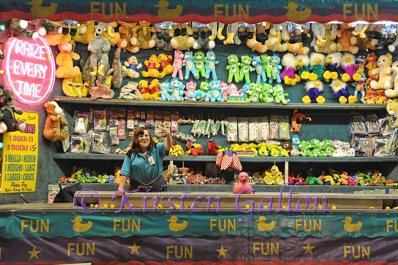 Rita Shulick encourages fair goers to come and try their luck at her duck game.