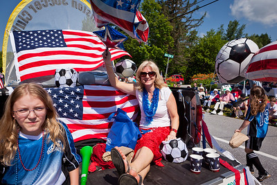 Jennifer Mitchell rides on the back of the Williston Soccer Clubs vehicle.  Photo:  DaveSchmidtPhoto.com