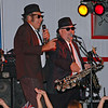 """Johnny and the sax player singing """"Everybody Needs Somebody"""" during the Blues Brothers segment."""