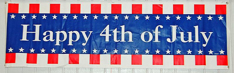 Large greeting banner at Deer Park Fourth Fest.