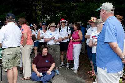 Anne Kuster talks to parade marchers before lining up.