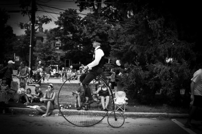 A man riding a penny-farthing.