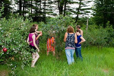 Gennie, Rachel, Abby, Tina, Alli, and John picking blueberries.