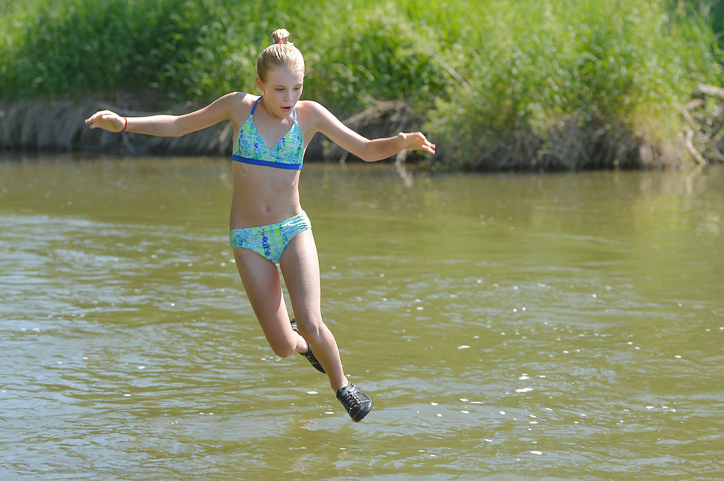 Justin Sheely | The Sheridan Press <br /> Twelve-year-old Aurora Switzer plunges into the Tongue River during the Independence Day celebrations Tuesday at Connor Battlefield State Historic Site in Ranchester. The town of Ranchester hosted its annual celebration on the Fourth of July with live music from the Two Tracks, family games, food and other special events including the wife-carrying competition.
