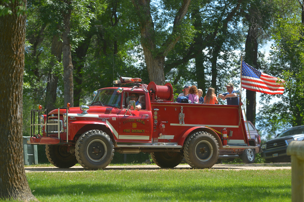 Justin Sheely | The Sheridan Press <br /> The Tongue River Fire District gives rides to children on a fire engine during the Independence Day celebrations Tuesday at Connor Battlefield State Historic Site in Ranchester. The town of Ranchester hosted its annual celebration on the Fourth of July with live music from the Two Tracks, family games, food and other special events including the wife-carrying competition.