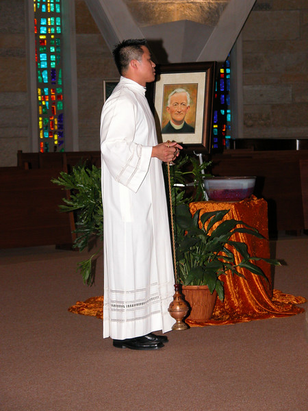 Fr. Thi waits to prepare the incense.