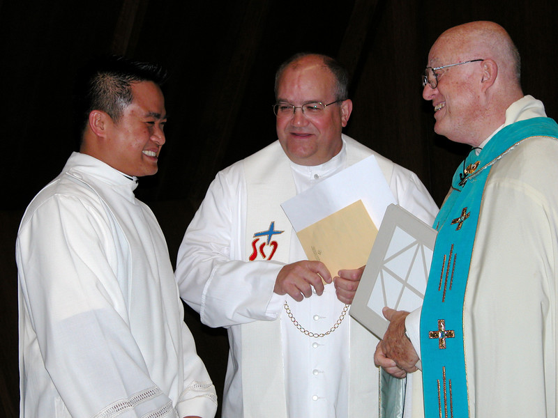 Frs. Thi Pham, Charles Bisgrove and Richard MacDonald before Fr. Charlie's mission ceremony.