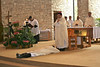 Fr. Greg before the bishop during the Litany of Saints