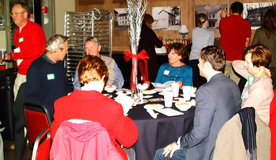 Debbie Blank | The Herald-Tribune At Third Place Event Center, Brookville, guests socialized and grabbed drinks before the dinner started. They were served roast beef, chicken, corn, salad and dessert by the Franklin County High School Band Boosters.