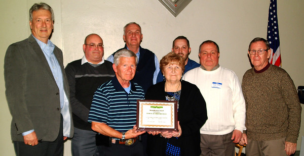 Debbie Blank | The Herald-Tribune<br /> The Town of Brookville was awarded one of two chamber beautification awards. Representatives include (front row from left) past Brookville Town Board member Bob O'Bryan and BTB member Cathy Pelsor; (back row) streets and park superintendent Brent Riehle, town administrator Tim Ripperger, BTB President Mike Biltz, BTB members Curtis Ward and Sam Schuck and past BTB member Rene Stivers.