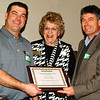 Debbie Blank | The Herald-Tribune<br /> The Corporate Citizen Award given to Dave O'Mara Contractor was accepted by Scott Works (left) and Jeff Fuller (right) and presented by board member Connie Gayda.