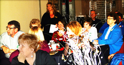Debbie Blank | The Herald-Tribune Attendees were attentive when awards were presented.