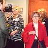 Debbie Blank | The Herald-Tribune<br /> At the Franklin County Chamber of Commerce annual dinner March 9, board member Jana Selke of Batesville Aviation (center) greets consultant Nick Lawrence of The Wheatley Group as Martha Shea of The Hermitage enters Third Place Event Center, Brookville.