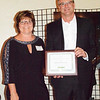 Debbie Blank | The Herald-Tribune<br /> Southeastern Insurance Services owners Paul (right) and Susan Moster were given the Beautification Award for remodeling their office at 560 Main St., Brookville.