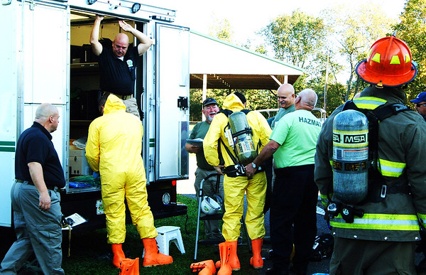 Debbie Blank | The Herald-Tribune<br /> Greater Cincinnati HAZMAT Analytical Response Unit members put on gear to respond to the pretend emergency.