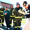 Debbie Blank | The Herald-Tribune<br /> A Greater Cincinnati HAZMAT Analytical Response Unit representative instructs firefighters on how to handle chlorine contamination. Brookville, Cedar Grove, New Trenton, Drewersburg, Blooming Grove and Oldenburg firefighters attended the training.