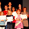 "Debbie Blank | The Herald-Tribune<br /> The 2018 poster contest theme was ""Watersheds: Our Water, Our Home."" Winners were judged on conservation message, visual effects, originality and university appeal. They were (front row from left) Alina Seals, second place; Virginia Sacksteder, third place; and Alexis Feller, first place, grades K-1; (middle row) Stephanie Wagner, third place; Jerod Rauch, second place; and Lily Feist, first place, grades 2-3; Bella Webb, third place; and Victoria Wuestefeld, second place, grades 4-6; (back row) district coordinator-treasurer Katie Hardin; Hunter Marshall, third place, and Clare Van Meter, first place, grades 7-9. Abby Baxter, first place, grades 4-6, and Jack Stirn, second place, grades 7-9,  were absent."