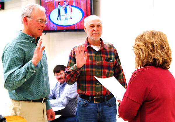 Debbie Blank | The Herald-Tribune<br /> After being re-elected, Franklin County Soil and Water Conservation District supervisors David Hartman (from left) and Tim Hofer repeat their oaths of office and were sworn in by county Clerk Neysa Raible.