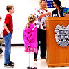 Debbie Blank | The Herald-Tribune<br /> With the help of two children, Lisa Hollars and Katie Hardin determine door prize winners and pass out their surprises.