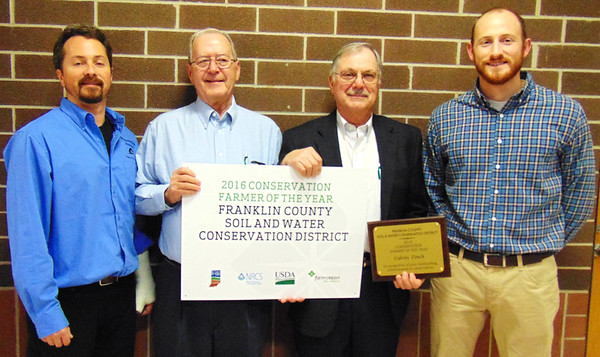 Debbie Blank | The Herald-Tribune<br /> Calvin Finch (third from left), Blooming Grove, was applauded as the 2016 Franklin County Soil and Water Conservation District Conservation Farmer of the Year. With him are (from left) district coordinator Chris Fox, district chairperson Michael T. Schwab and Natural Resources Conservation Service district conservationist Evan Divine. The honoree was praised for 100 percent no till, planting cover crops since 2012 and also grass buffer strips along a stream, rotational cattle grazing, fencing of streams, timber stand improvement and invasive species control on woodlands.