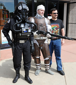 Jeff Anderson, left, an Imperial pilot, Aaron Garber,  playing Dengar, the bounty hunter, and regular person, Sean O'Neill, pose for a photo outside Time Warp Comics. Time Warp Comics and Games in Boulder is one of thousands of comic book shops around the world celebrating the comic book art form on Saturday, May 5th. On Free Comic Book Day, over 3.3 million comic books will be given away by participating stores, introducing as many people as possible to the wonders of comic books! For a video and more photos of comic book day, go to www.dailycamera.com. Cliff Grassmick / May 5, 2012