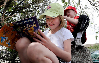 Bridget Wray, 6, and brother, Joe, 8, take advantage of the free comics available on Saturday. Time Warp Comics and Games in Boulder is one of thousands of comic book shops around the world celebrating the comic book art form on Saturday, May 5th. On Free Comic Book Day, over 3.3 million comic books will be given away by participating stores, introducing as many people as possible to the wonders of comic books! For a video and more photos of comic book day, go to www.dailycamera.com. Cliff Grassmick / May 5, 2012