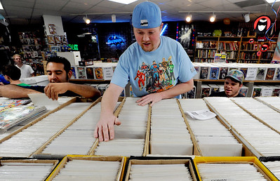 Michael Hernandez, left, and Tyler Locke, of Time Warp Comics, look through stacks of comics on Saturday. Time Warp Comics and Games in Boulder is one of thousands of comic book shops around the world celebrating the comic book art form on Saturday, May 5th. On Free Comic Book Day, over 3.3 million comic books will be given away by participating stores, introducing as many people as possible to the wonders of comic books! For a video and more photos of comic book day, go to www.dailycamera.com. Cliff Grassmick / May 5, 2012