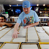 "Michael Hernandez, left, and Tyler Locke, of Time Warp Comics, look through stacks of comics on Saturday.<br /> Time Warp Comics and Games in Boulder is one of thousands of comic book shops around the world celebrating the comic book art form on Saturday, May 5th. On Free Comic Book Day, over 3.3 million comic books will be given away by participating stores, introducing as many people as possible to the wonders of comic books!<br /> For a video and more photos of comic book day, go to  <a href=""http://www.dailycamera.com"">http://www.dailycamera.com</a>.<br /> Cliff Grassmick / May 5, 2012"