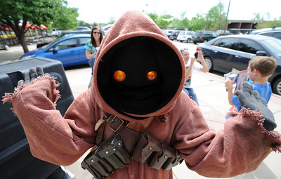 One of the popular Star Wars characters made a visit to Time Warp Comics. Time Warp Comics and Games in Boulder is one of thousands of comic book shops around the world celebrating the comic book art form on Saturday, May 5th. On Free Comic Book Day, over 3.3 million comic books will be given away by participating stores, introducing as many people as possible to the wonders of comic books! For a video and more photos of comic book day, go to www.dailycamera.com. Cliff Grassmick / May 5, 2012