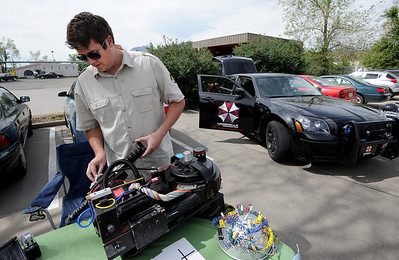 Kevin Henry of Colorado Movie Cars, works on a Ghostbusters proton pack at the event on Saturday. Time Warp Comics and Games in Boulder is one of thousands of comic book shops around the world celebrating the comic book art form on Saturday, May 5th. On Free Comic Book Day, over 3.3 million comic books will be given away by participating stores, introducing as many people as possible to the wonders of comic books! For a video and more photos of comic book day, go to www.dailycamera.com. Cliff Grassmick / May 5, 2012