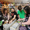 "Kira Berry, left, Laura Gomez, Ryan Earles, and Lili Armstrong, look through comics at Time Warp. The ghoul on the left refused to give his name.<br /> Time Warp Comics and Games in Boulder is one of thousands of comic book shops around the world celebrating the comic book art form on Saturday, May 5th. On Free Comic Book Day, over 3.3 million comic books will be given away by participating stores, introducing as many people as possible to the wonders of comic books!<br /> For a video and more photos of comic book day, go to  <a href=""http://www.dailycamera.com"">http://www.dailycamera.com</a>.<br /> Cliff Grassmick / May 5, 2012"