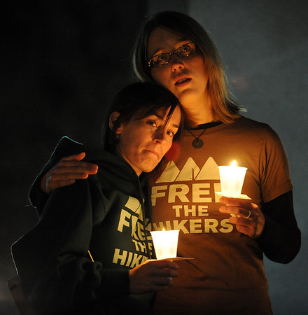 "Shannon Bauer, left, is comforted by Natalie Senske as they listen to music at the vigil, Shannon's brother Shane, is one of the detained hikers in Iran.<br /> A vigil in support of three American hikers detained in Iran  was held at the Pearl Street courthouse lawn Sunday evening. Shane Bauer, Sarah Shourd and Josh Fattel were arrested July 31, 2009 as they strayed across an unmarked border during a  hiking trip in Iraqi Kurdistan.<br /> For more photos of the vigil, go to  <a href=""http://www.dailycamera.com"">http://www.dailycamera.com</a>.<br /> Cliff Grassmick / November 8, 2009"