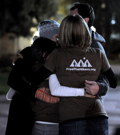 Supporters of the three detained hikers hug before the vigil.<br /> A vigil in support of three American hikers detained in Iran  was held at the Pearl Street courthouse lawn Sunday evening. Shane Bauer, Sarah Shourd and Josh Fattel were arrested July 31, 2009 as they strayed across an unmarked border during a  hiking trip in Iraqi Kurdistan.<br /> Cliff Grassmick / November 8, 2009