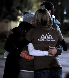 Supporters of the three detained hikers hug before the vigil. A vigil in support of three American hikers detained in Iran  was held at the Pearl Street courthouse lawn Sunday evening. Shane Bauer, Sarah Shourd and Josh Fattel were arrested July 31, 2009 as they strayed across an unmarked border during a  hiking trip in Iraqi Kurdistan. Cliff Grassmick / November 8, 2009