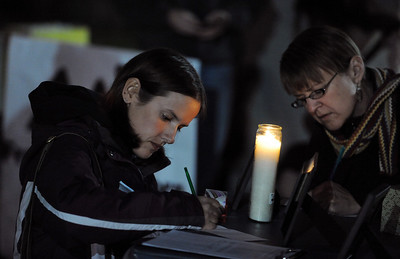 Lauren Daniels, left, and Sarah Kubley, write letters to the detained hikers. A vigil in support of three American hikers detained in Iran  was held at the Pearl Street courthouse lawn Sunday evening. Shane Bauer, Sarah Shourd and Josh Fattel were arrested July 31, 2009 as they strayed across an unmarked border during a  hiking trip in Iraqi Kurdistan. Cliff Grassmick / November 8, 2009